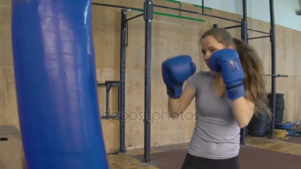 Woman Does Muay Thai Kickboxing Training At The Gym