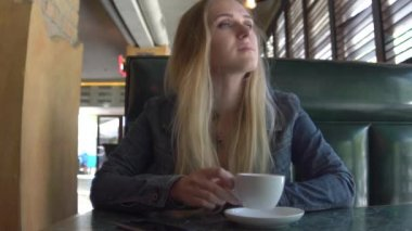 Young Attractive Woman Drinking Coffee In Cafe, Steadicam Shot Slow Motion
