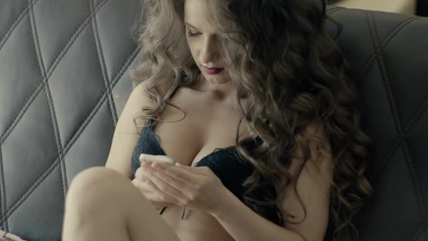 Sexy Woman Texting On Bed In Black Body Slow Motion