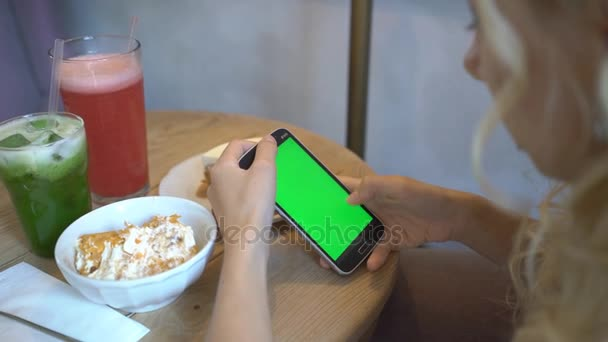 4K Attractive Young Woman Using Her Green Touch Screen Mobile Cell Phone In Cafe