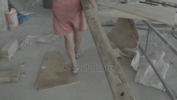 Slow Motion Construction Worker Carrying Wood Planks