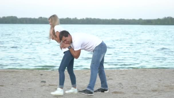Happy Young Couple Having Fun Together On The Beach, Slowmotion