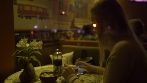 4K Beautiful Girl Using App On Phone Drinking Coffee