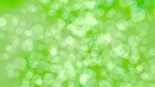 Zelené pozadí abstraktní, bezešvé smyčka. Mnoho kolo osvětlení částice letící na rozmazané zpět, stejně jako efekt bokeh. Příroda nebo ekologické téma. 3D vykreslování.
