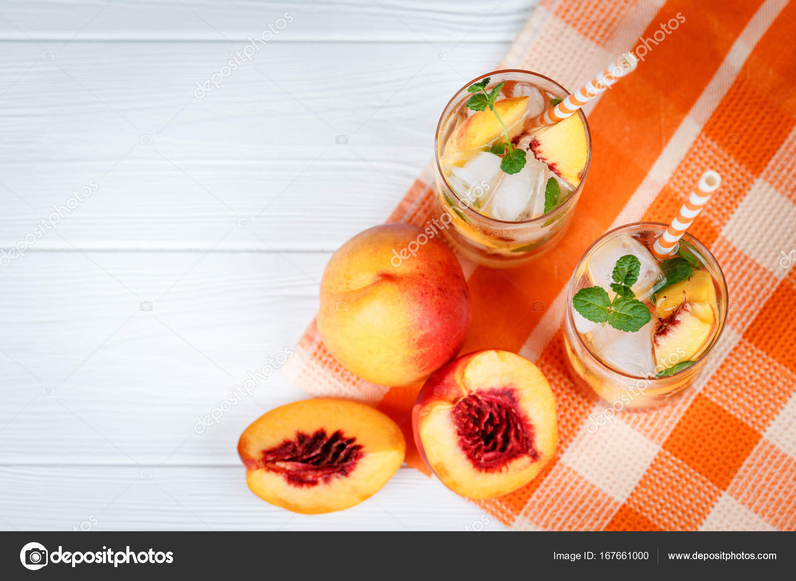 peach lemonade with ice and mint leaves homemade lemonade of ripe