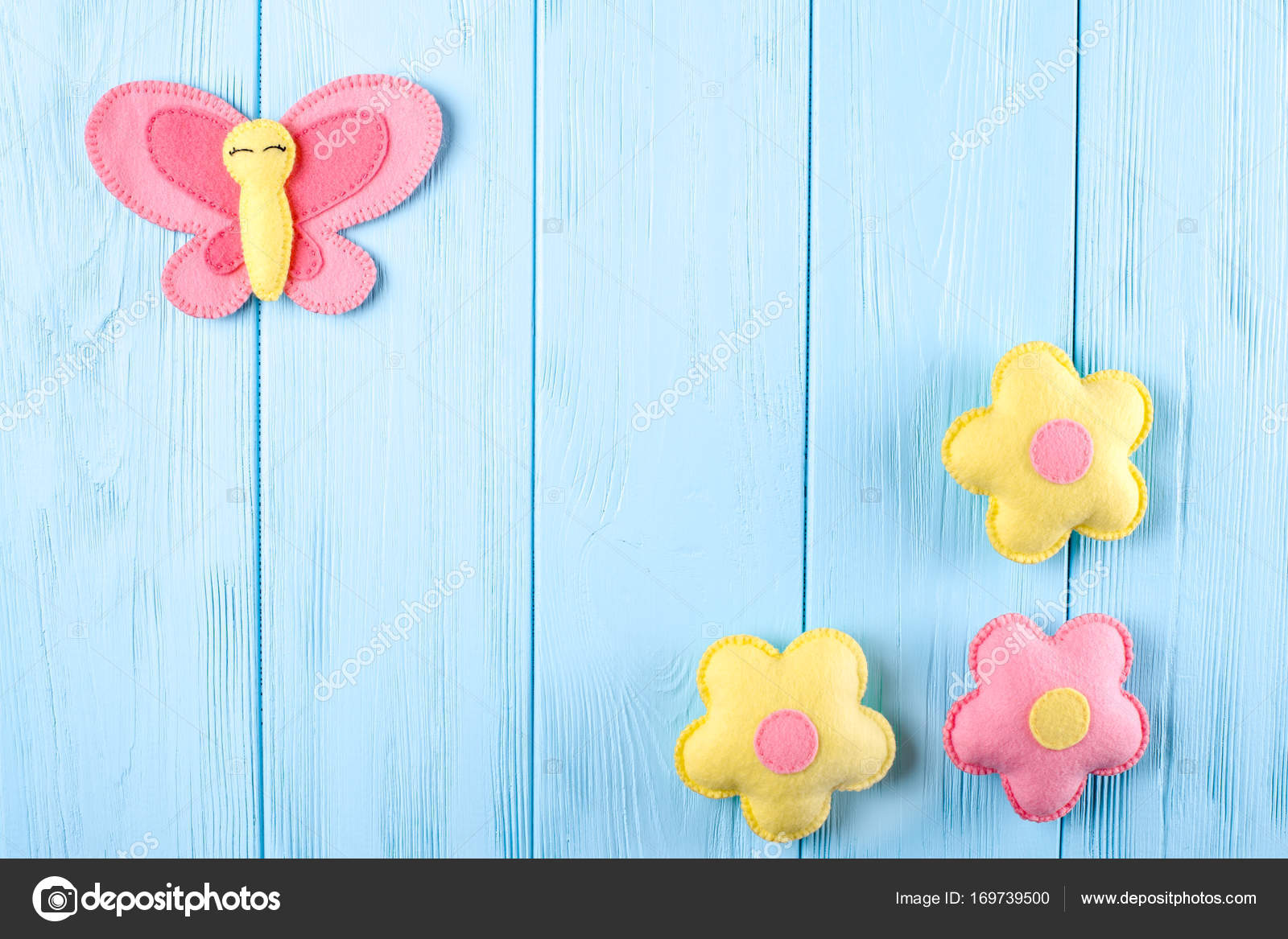 Craft Pink And Yellow Butterfly Flowers With White Paper Copyspace On Blue Wooden Background Hand Made Felt Toys Abstract Sky