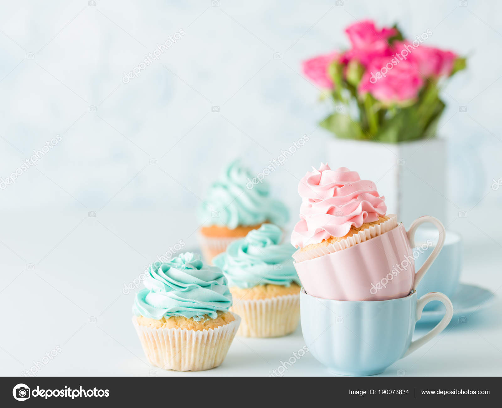 Blue pastel banner with decorated cupcakes, cup of coffe with milk ...