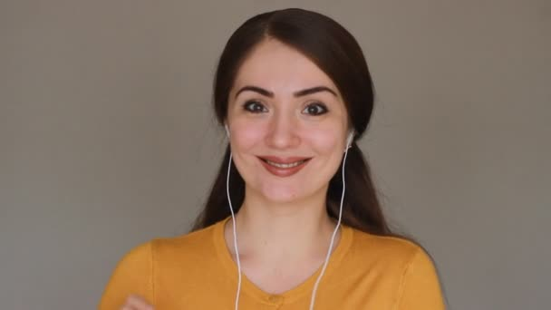 Happy young woman having a video chat, as seen from the point of view of the computer screen. Beautiful girl brunette talking on internet, looks at the web camera of a computer and smiling.