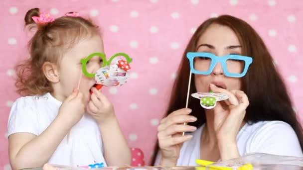 Happy Birthday Mother And Daughter Dress Glasses And Blowing Horns The Concept Of A Holiday Party Birthday Decor For Celebration Portrait Of A Young Woman And A Child Close Up