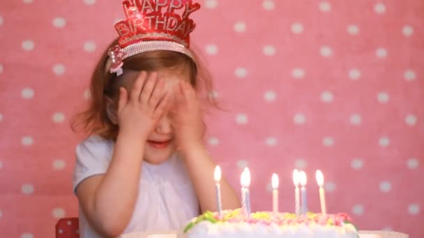 Happy Birthday Cute Child Make A Wish And Blows Out Candles On Cake At Party Funny Little Girl Pink Background Stock Footage