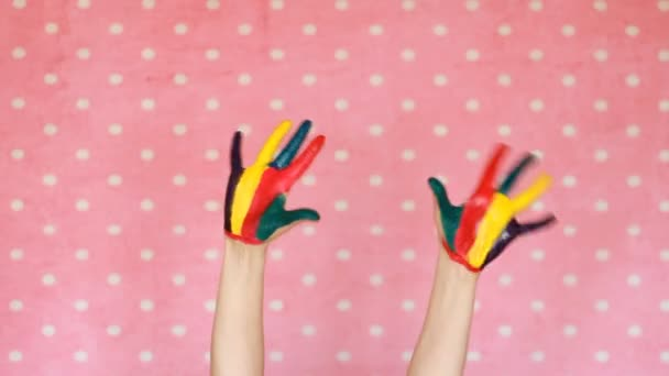 Colorful painted hands. Creative. Art. Hand in color paint. Dirty palms. Pink background.