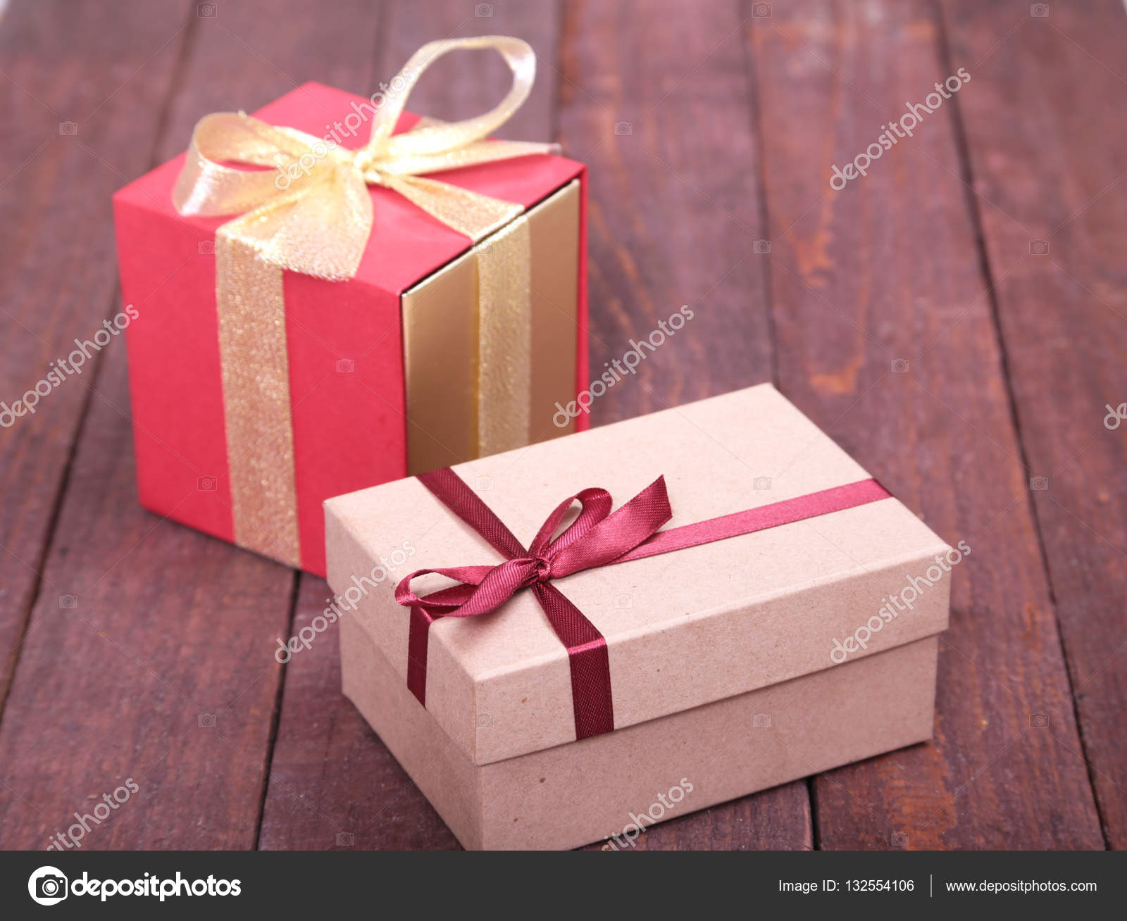Gift boxes with bow on wood background — Stock Photo © piratka20073 ...
