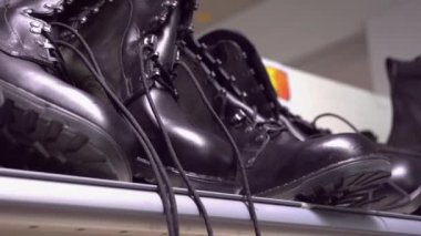The black military boots in the shelf