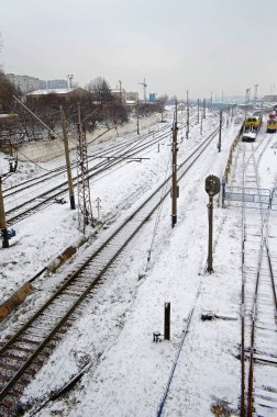Snow covered many railway lines in the depot, aerial view