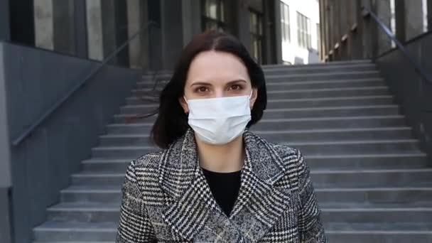 Girl in a medical mask. Stay at home. Pandemic coronavirus. COVID-19. SARS-CoV-2. 2019-nCoV.