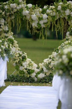Heart frame made of beautiful flowers. Arch made for wedding ceremony