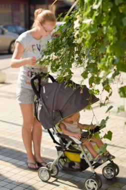 woman with a child in a stroller