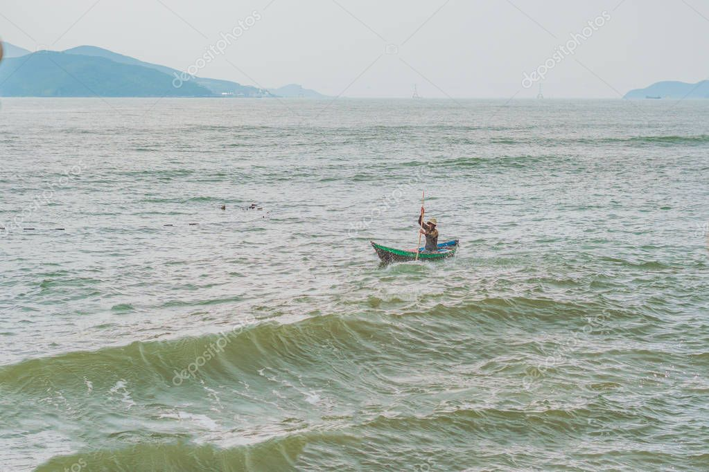 Vietnamese fisherman  in a boat