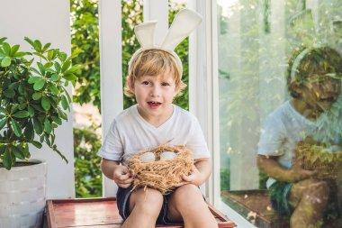 child boy wearing bunny ears