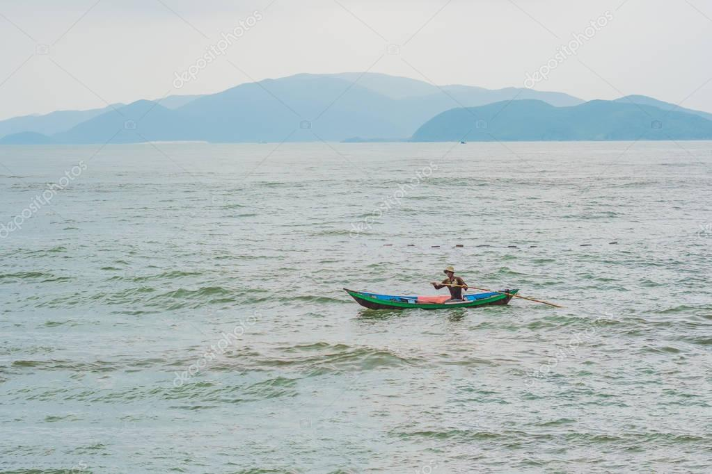 Vietnamese fisherman  in a boat