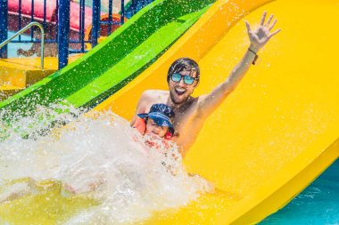 Father and son on a water slide