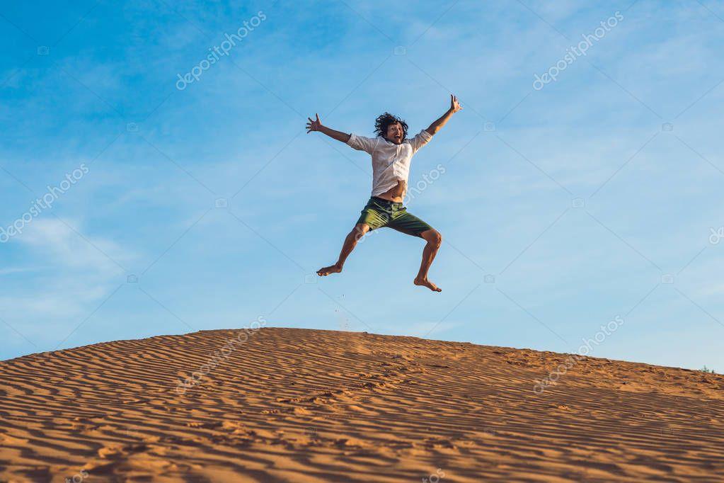 young man jumping barefoot