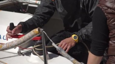 Slowmotion shot of a man using a yachting winch