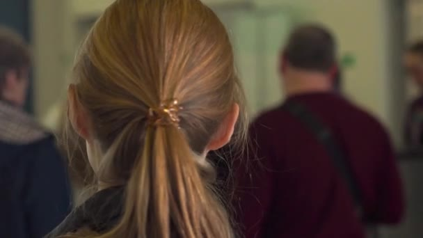 Slowmotion shot of a young woman at a boarding gate at an airport