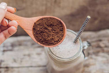 Drink from carob and kerob powder in a wooden spoon