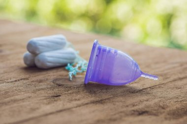 Different types of feminine hygiene products - menstrual cup and tampons