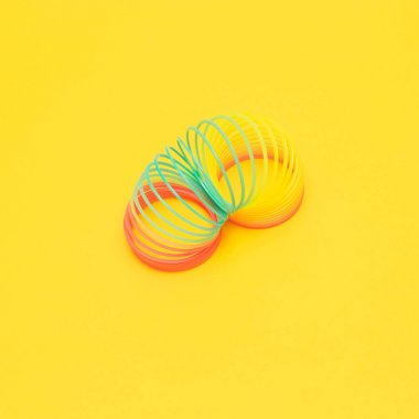 rainbow spiral on yellow background