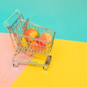 Self-service supermarket concept, shopping trolley cart with fresh grocery products and fruits