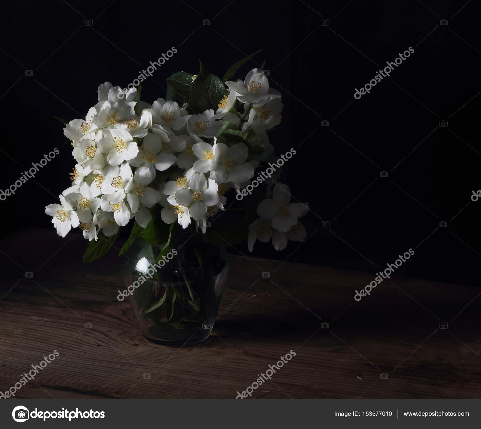 Jasmine bouquet of fresh flowers is on the table stock photo jasmine bouquet of fresh flowers is on the table stock photo izmirmasajfo