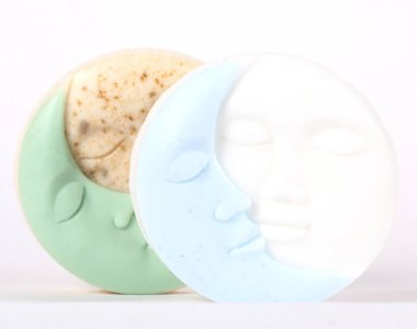 Handmade soap in the shape of the sun and moon on a white background