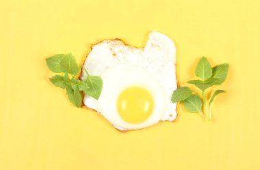 Fried eggs on bright background