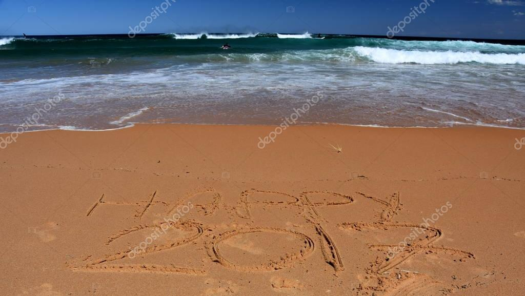 Happy 2017  written in sand, on tropical beach.