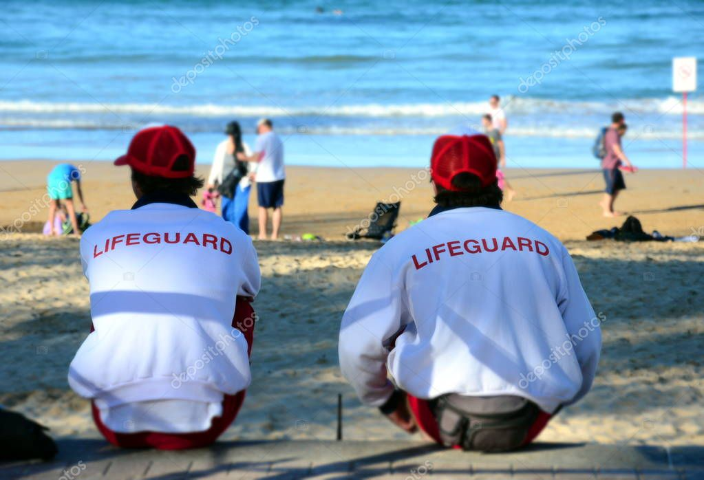 two lifeguards on beach