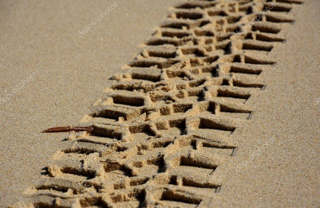 Wheel track in the sand texture.