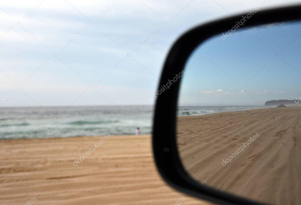 Car driving on beach