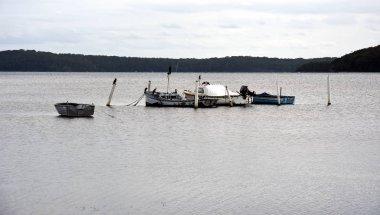 Boats moored at lake Macquarie