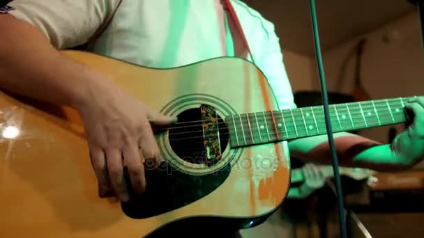 Acoustic guitar. Musician plays rock style music. Six strings