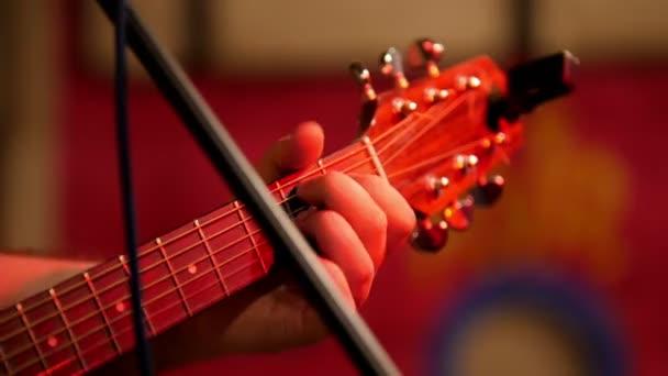 Musician playing acoustic guitar - guitar soundboard