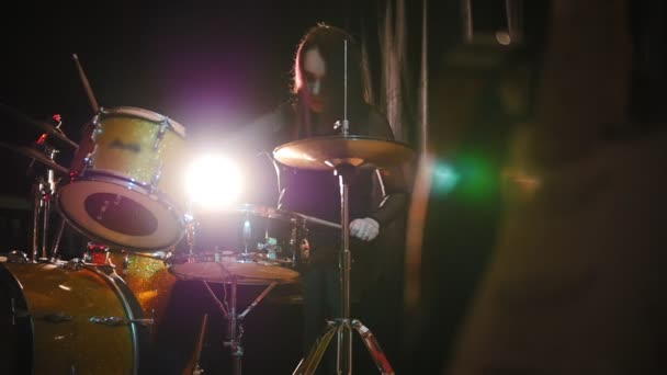 Teen rock music - emotional girl percussion drummer performing with drums, slow-motion