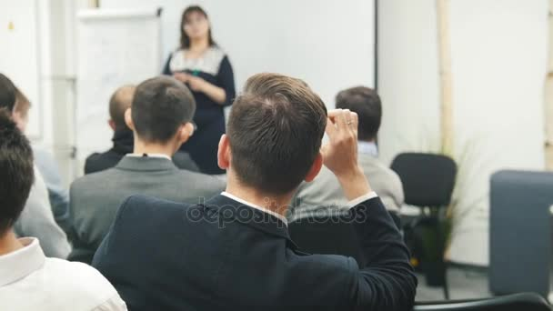 Man in fashion suit at lecture - business seminar