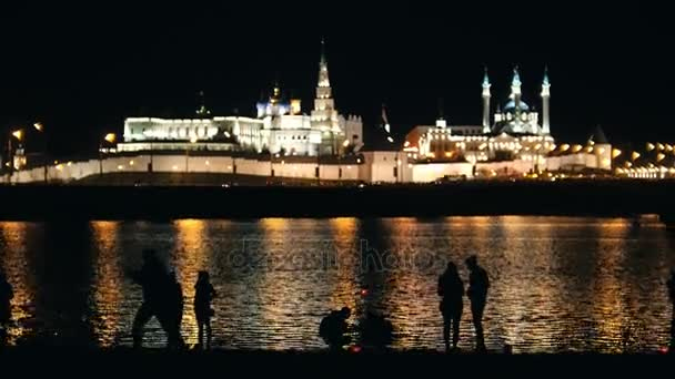 Kazan, Russia, 12 may 2017 - Festival of water Lanterns on Kazanka river - silhouettes in front of kremlin