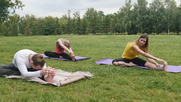 Group of sportsmans perform yoga training outdoor