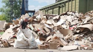 Kazan, Russia, 22 june 2017, territory of the plant ECOGRAD -heaps of cardboard at industrial landfill, ecology concept