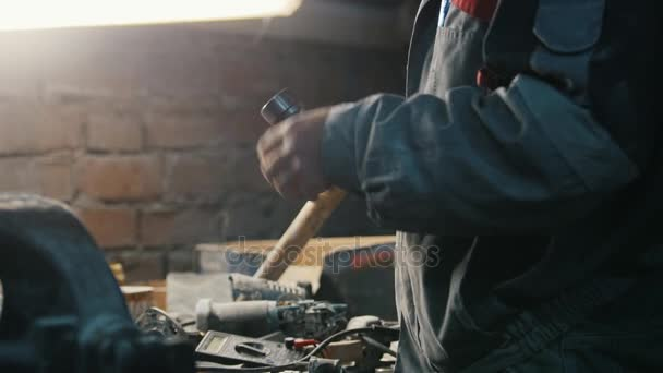 Industrial carpenter worker in dusty vintage workshop, close up