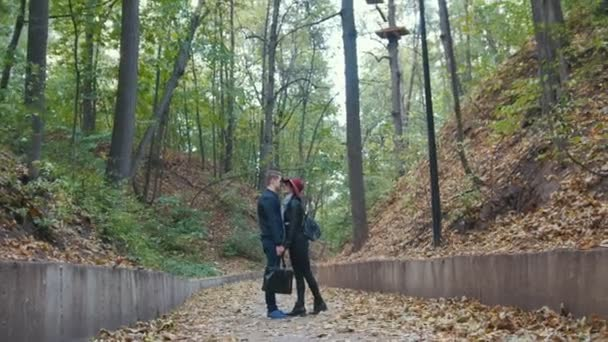 Romantic couple in autumn park among yellow leaves