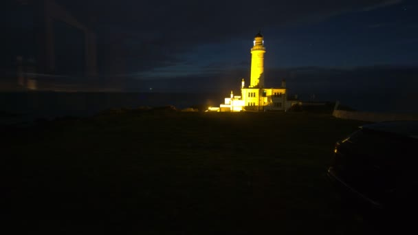 Working lighthouse at night, time-lapse